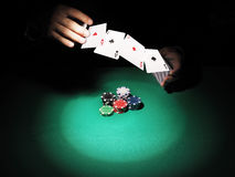 Man playing poker on green background. Royalty Free Stock Photo