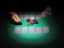 Man playing poker on green background. Royalty Free Stock Photography