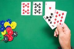 Man playing poker Stock Images