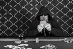 A man playing poker sitting at a table royalty free stock photos