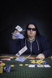A man playing poker sitting at a table Stock Photography
