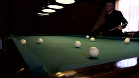 Man playing pool, billiards. Boys playing Russian billiards pool in a beautiful institution stock footage
