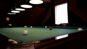 Man playing pool, billiards. Boys playing Russian billiards pool in a beautiful institution stock video