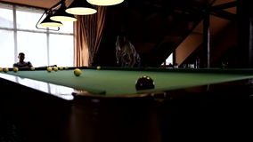 Man playing pool, billiards. Boys playing Russian billiards pool in a beautiful institution stock video footage