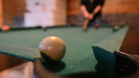 Man playing pool. Concentrated young man playing pool stock footage