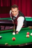 Man playing pool. Stock Photos