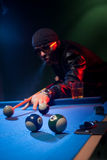 Man playing pool lining up on the cue ball Stock Photography