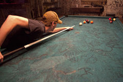 Man playing pool, Mississippi. A man playing pool in a bar in Mississippi Stock Photography