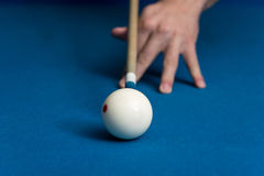 Man Playing Pool About to Hit Ball Stock Photography