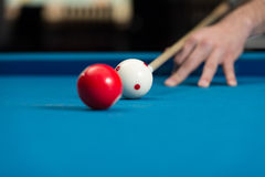 Man Playing Pool About to Hit Ball Stock Photo