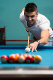 Man Playing Pool Stock Photo