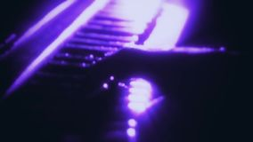 Man Playing a Purple Particles Piano - Hands Close Up - Motion Background. Glowing Man Playing a Purple Particles Piano - Hands Close Up - Motion Background stock video footage