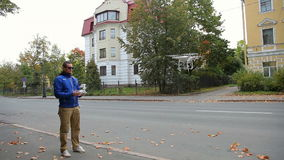 Man playing with a quadcopter drone stock footage