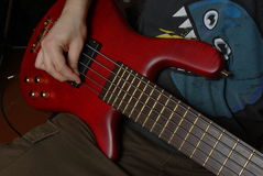 Man playing on red guitar Stock Images