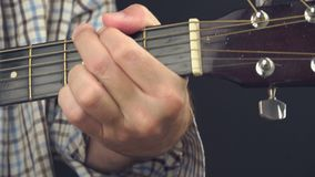 Man playing rock tune chords on acoustic guitar stock video footage