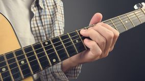 Man playing rock tune chords on acoustic guitar stock footage