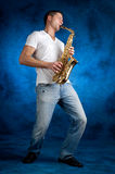 Man playing   sax. Man  playing sax on blue background Stock Photo