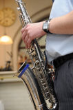 Man playing sax or brass horn (musical instrument). Hands close up royalty free stock photo