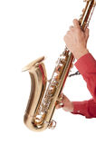 Man playing saxophone in closeup. Male entertainer playing a brass tenor saxophone with silver valves and pearl buttons in close up Stock Photos