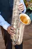 Man Playing the Saxophone. Man playing a saxophone with emotion Royalty Free Stock Image