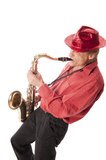 Man playing saxophone leaning backwards. Male artist playing a brass tenor saxophone with silver valves and pearl buttons leaning backwards Stock Photos