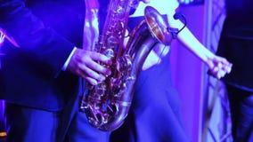 Man playing saxophone. Musicians man playing saxophone on wedding banket stock video