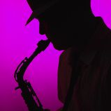 Man Playing Saxophone in Silhouette Stock Photos