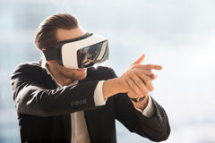 Man playing in shooter game with VR headset stock images