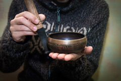 Man playing on a singing bowl stock images