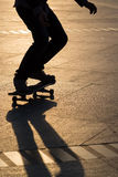 Man playing skateboard. Silhouette of man playing skateboard in park Royalty Free Stock Photo