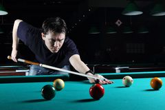 Man playing snooker. Royalty Free Stock Images