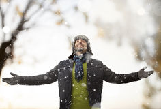 A man playing with snow Royalty Free Stock Images