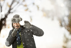 A man playing with snow Stock Photo
