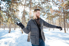 Man playing with snow in winter park Royalty Free Stock Photos