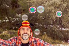 Man playing with soap bubbles. Funny picture Stock Photography