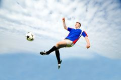 Man playing Soccer. Adult man playing soccer outdoors royalty free stock photo