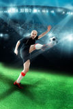 Man playing soccer and shooting a ball in the game Royalty Free Stock Image