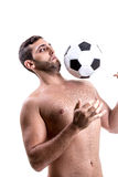 Man playing soccer on white background Royalty Free Stock Image