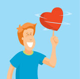 Man playing with spinning heart Royalty Free Stock Image