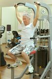 Man playing sports in a gym Stock Images