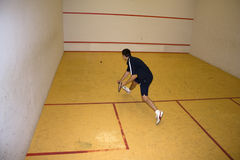 Man playing squash Stock Images