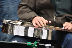 Man Playing Steel Guitar. With Picks Royalty Free Stock Photos