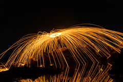A man playing steel wool on the beach Stock Photo