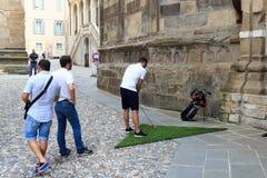 Man playing Street golf during an official tournament in Citta Alta (historic city) of Bergamo Stock Photos