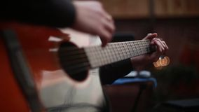 Man playing on a 6-string acoustic guitar stock footage