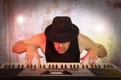 Man playing synthesizer Stock Photo