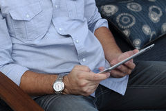 Man playing on a tablet. Technology use at everyday life Royalty Free Stock Images