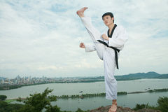 Man playing with taekwondo outdoor Royalty Free Stock Photography