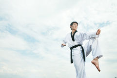 Man playing with taekwondo outdoor Stock Image