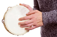 Man playing a tambourine Royalty Free Stock Photos